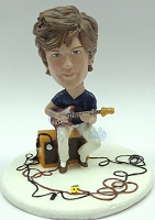 Premium male playing his guitar sitting on his amp custom bobblehead doll