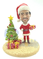 Santa holding a present while next to a tree custom bobblehead Premium