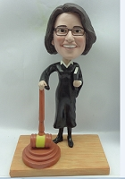 A premium female judge custom bobblehead doll