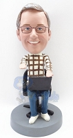Male sitting with computer custom bobblehead doll figurine
