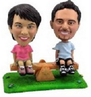 See Saw on grass couple custom bobblehead doll