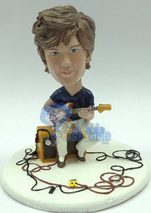 Male playing his guitar sitting on his amp custom bobblehead doll Premium