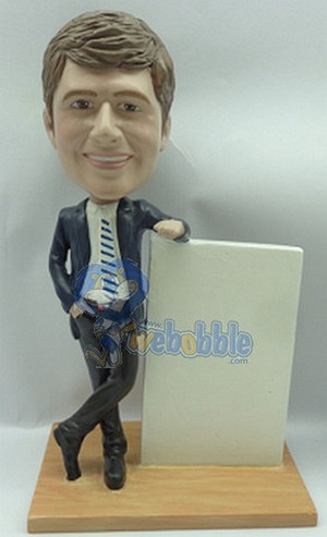 executive in suit, leaning on a sign custom bobblehead (bobbing doll)